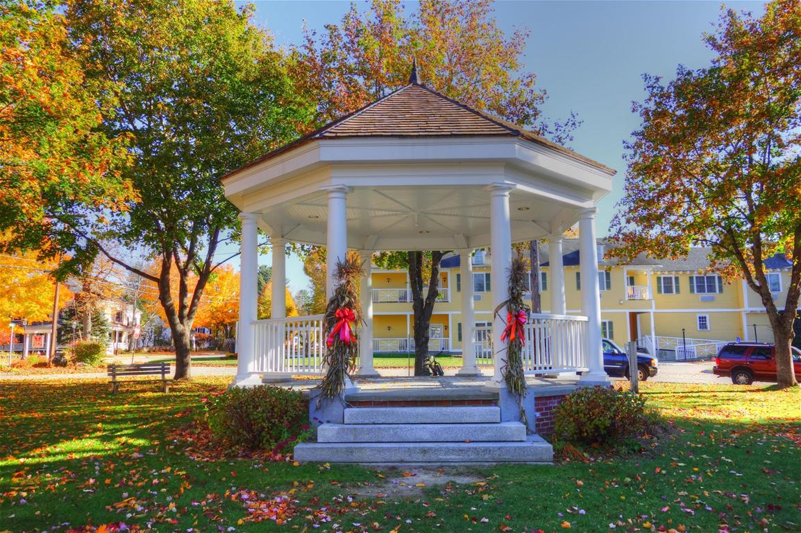 White Bandstand with corn stalks and red ribbons on fall day