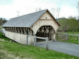 Small covered bridge on walking path.